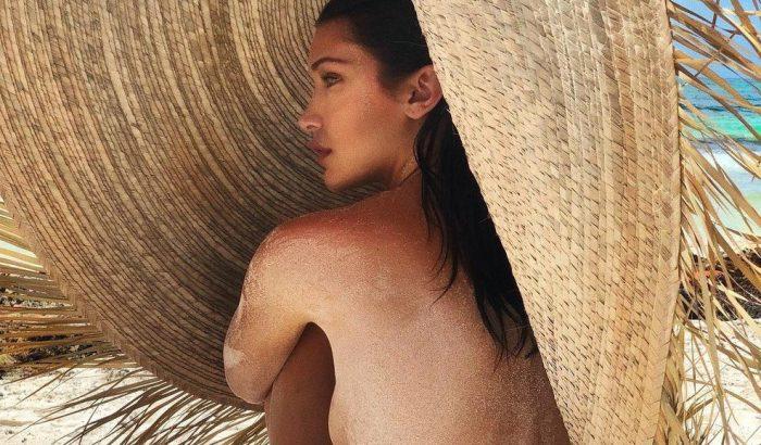 Bella Hadid brutálisan nagy szalmakalapban meztelenkedik