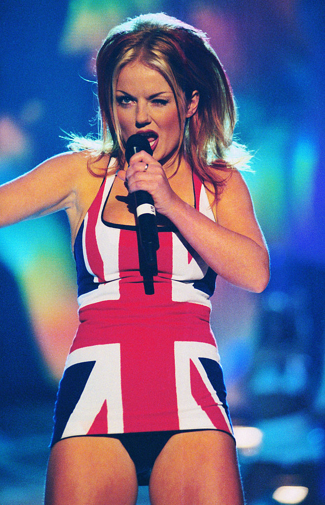 British singer Geri Halliwell, a.k.a. Ginger Spice of the Spice Girls on stage at the Brit Awards, in a union jack dress, 24th February 1997. (Photo by Dave Benett/Hulton Archive/Getty Images)