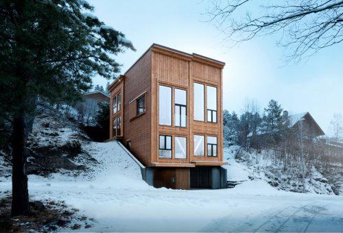 Fényárban úszó norvég faház